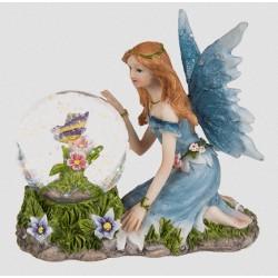 Figurine fée bleu avec des fleurs et papillons dans une boule à paillettes
