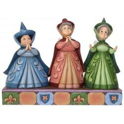 Figurine Disney Tradition la fée Flora, Pâquerette et Pimprenelle