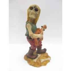 Figurine tête de mort avec guitare