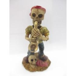 Figurine tête de mort avec saxophone