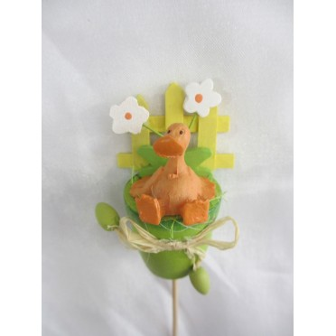 Canard dans un pot vert à piquer